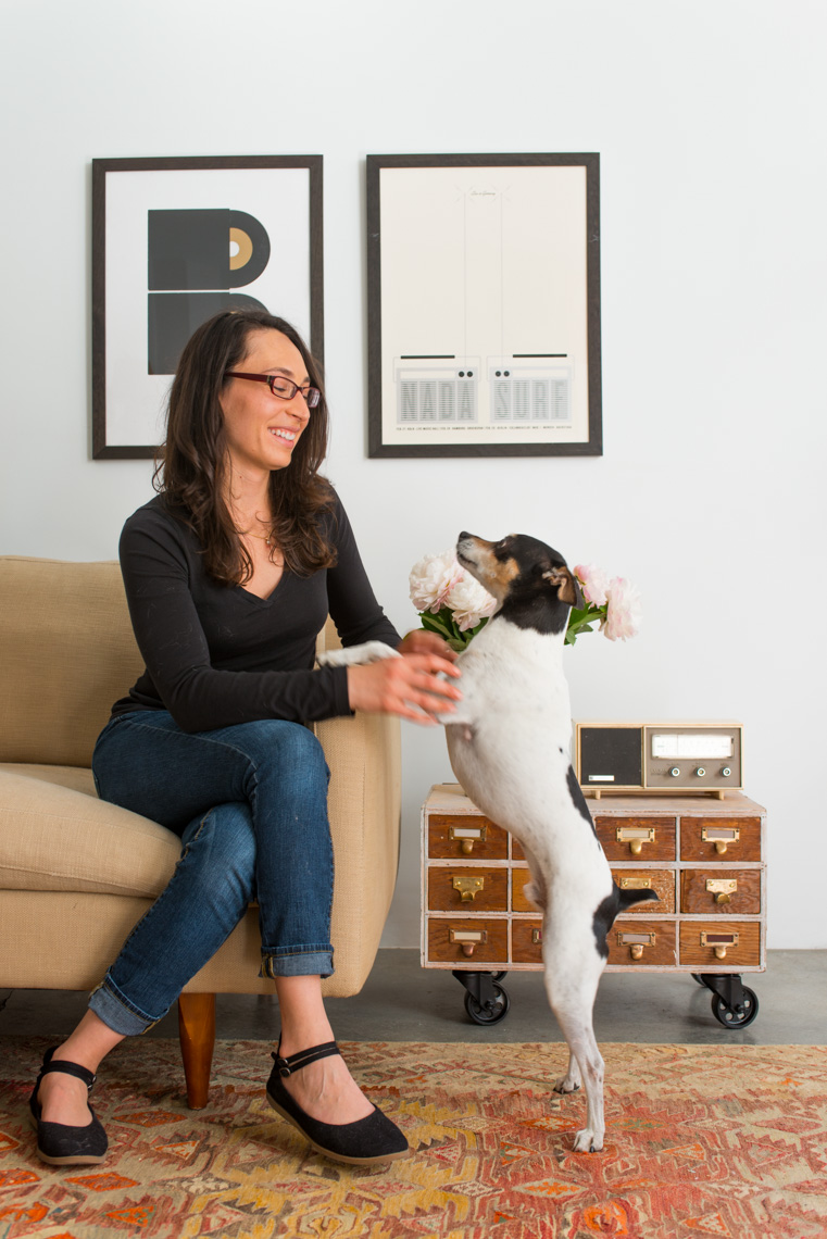 Woman in modern interior with dog